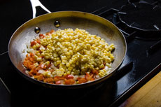 Skillet peppers, corn and onions with cumin