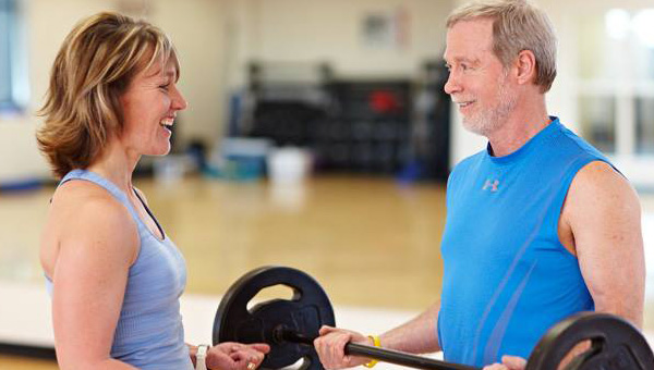 Woman trainer and old man